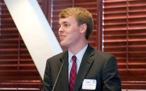 Board Member Thomas Rhodes, CPCU introducing Speaker