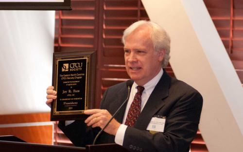 Deane Tolman presents award to Past President Jay Baas