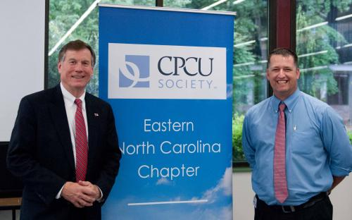 Mike Causey and CPCU Chapter President Dennis Carroll