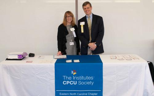 Paul Hoover and Peggy Bird Eastern NC CPCU Society registration.