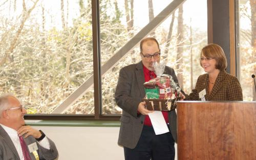 President Amy Craig presents a thank you gift to speaker Joe Dittmar