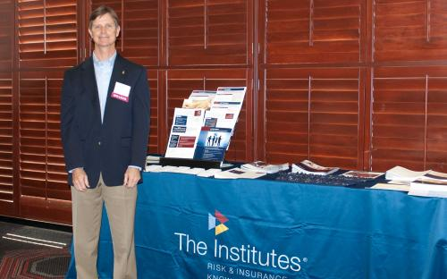Charles Runge at The Institutes Booth
